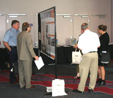 Picture of attendees viewing and discussing posters