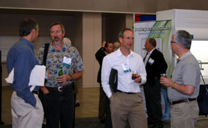 Picture of attendees talking at the Technology and Services Fair Evening Reception