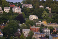Picture of historic homes dotting the hillside overlooking downtown Providence.